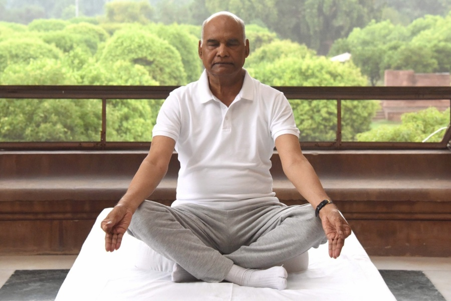 New Delhi: President Ram Nath Kovind practices yoga asanas - postures - on the occasion of 6th International Yoga Day in New Delhi on June 21, 2020. (Photo: IANS/RB) by .