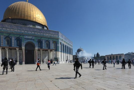 JERUSALEM, Aug. 11, 2019 (Xinhua) -- Palestinians clash with Israeli police at the Al-Aqsa Mosque compound in East Jerusalem, Aug. 11, 2019. Clashes erupted on Sunday in East Jerusalem's holy site between Muslim worshippers and Israeli police, sparking fresh tensions, Israeli and Palestinian officials said. The Palestinian Red Crescent said at least 14 Palestinians were injured as the Israeli police stormed the Al-Aqsa Mosque compound. The Al-Aqsa Mosque compound, known to the Jewish people as the Temple Mount, is sacred to both Muslims and Jews. (Photo by Muammar Awad/Xinhua/IANS) by .