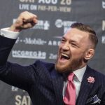 LOS ANGELES, July 12, 2017 (Xinhua) -- UFC fighter Conor McGregor reacts during a news conference at the Staples Center in Los Angeles, the United States on July 11, 2017. Conor McGregor will fight with boxer Floyd Mayweather Jr. in a boxing match in Las Vegas on August 26. (Xinhua/Zhao Hanrong/IANS) by .
