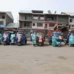 Srinagar: A fleet of cargo autos with their drivers wearing Personal Protective Equipment (PPE) suits ready to deliver essential commodities across Srinagar during the extended nationwide lockdown imposed to mitigate the spread of coronavirus pandemic, on Apr 16, 2020. (Photo: IANS) by .