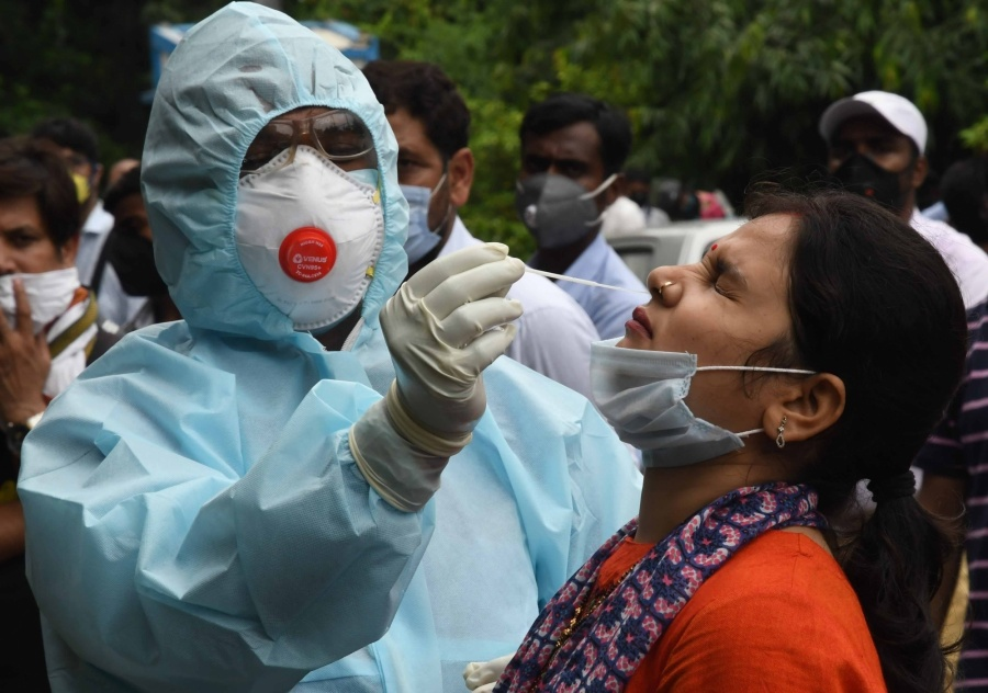 Patna: A health worker collects swab samples for COVID-19 testing outside Hotel Patliputra Ashok in Patna on July 29, 2020. (Photo: IANS) by .